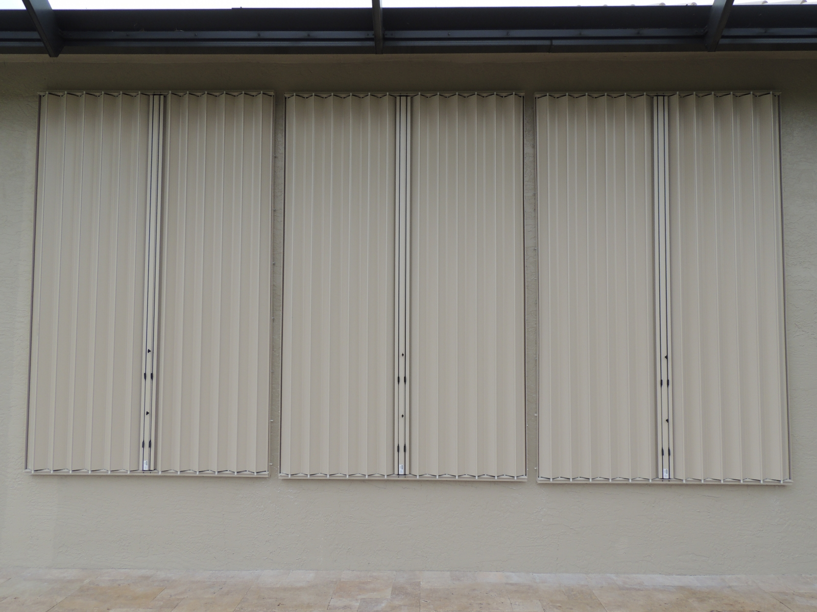 who offers accordion shutters palm beach?